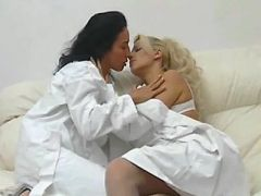 Mature lesbian in stockings caresses nurses pussy