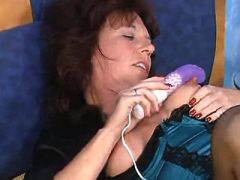 Hot mature lesbian in stockings plays with dildo