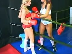 Young sports lesbians caress each other on ring