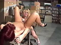 Mature lesbians have fun with dildo on warehouse