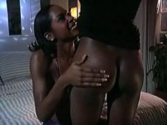 Young ebony lesbians caress each other in bed
