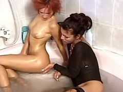 Lusty lesbians masturbate and lick pussies in bath