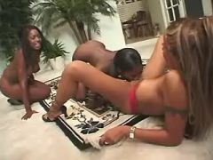 Three black lesbians relax with sextoys on floor