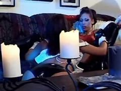 Hot lesbians in latex enjoy big sextoys on sofa