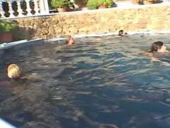 Chesty young lesbians have fun in hotels pool