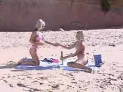 Two yummy lesbians caress each other on beach