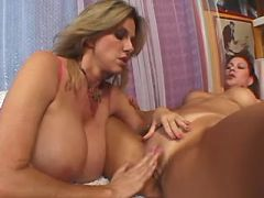 Mature lesbians with big boobs caress each other