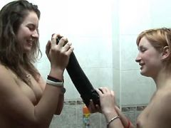 Sexy lesbian dildofucks yummy chick in bathroom