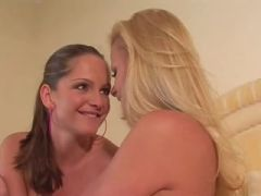 Lesbian brunette and blonde kissing