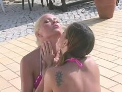 Sexy girls caress each other and then have sex at the pool