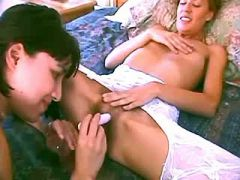 Two beautiful teen lesbians have fun with dildos